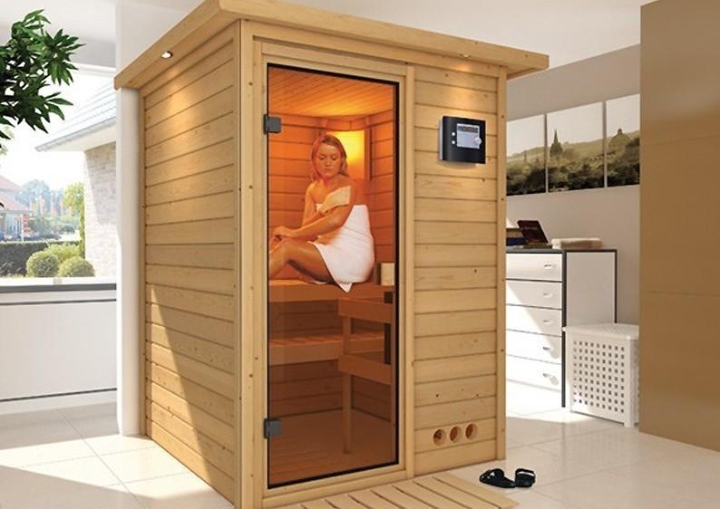 Woodfeeling 38 mm Massiv Sauna Svenja (Fronteinstieg) mit Dachkranz und graphitfarbener Ganzglastür
