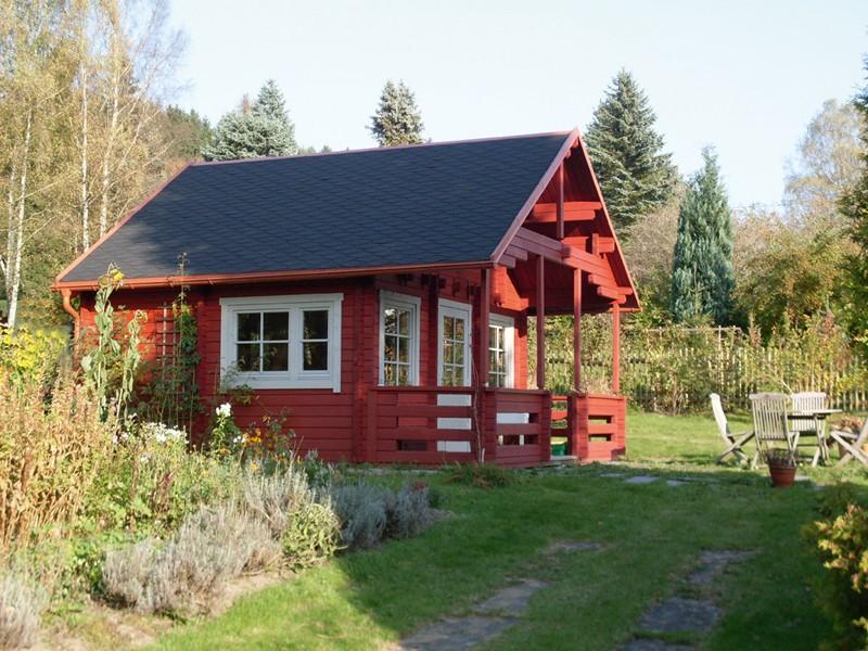 Wolff Finnhaus Ferienhaus aus Holz 70mm Blockbohlenhaus Sauerland 70-A