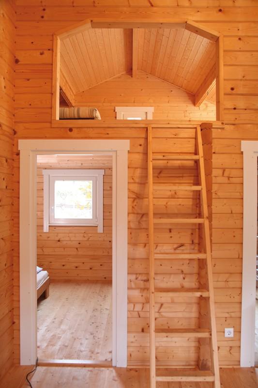 Wolff Finnhaus Ferienhaus aus Holz 70mm Blockbohle Spessart 92-D mit Schlafboden